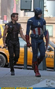 """Okay, Hawkeye, we're ,about to cross the street. Hold my hand."" ""But, Cap, I can get across the street just fine on my own..."" ""Just do it!"" ""Fine. Now people will definitly talk..."""