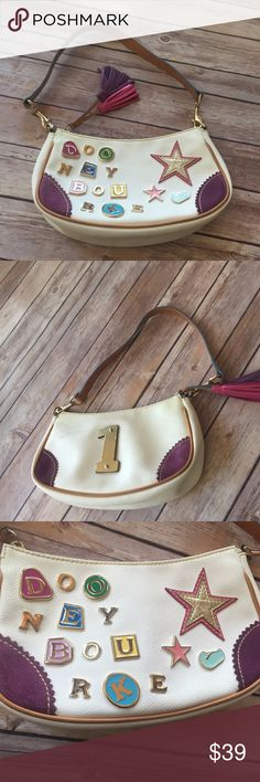 """Dooney and Bourke Stars Charm Tassel Handbag Purse This is a nice Dooney bag it is great condition there is a scuff next to the #1 I show it in my pictures. It is a White Leather  The Bag length is 10"""", Height is 5.5"""" , Depth is 3"""" with a 10"""" Strap Drop  Location Box 14 Dooney & Bourke Bags Totes"""
