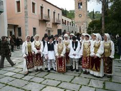 Traditional dancers in Greek costmes at the Monastery of Hosios Louka. Higher resolution files at http://commons.m.wikimedia.org/wiki/File:Traditional_dancers_in_the_Monastery_of_Hosios_Loukas_2.jpg