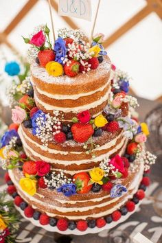 Bright berries, roses, flowers, baby's breath spring cake - this would be lovely for a rustic outdoor barn or forest wedding cake!!! I love it.