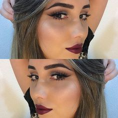 Deep wine colored lipstick, bold brow, and smokey eye