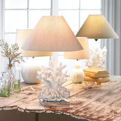 Shine a light on one of natures most fascinating designs! This gorgeous white coral table lamp features a stainless steel square base neutral shade and a fantas
