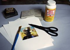Modgepodge sanding block, printed pictures, tiles from home depot or some place similar. You can make magnets too, super glue a magnet... get creative with hanging.  Tutorial used double sided sticky tape... That makes me nervous for my walls paint.