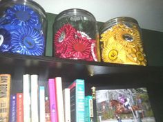 not the best photo - but this is how I display my ribbons at home - big candy jars up on top the bookshelves in the library