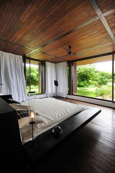 Master bedroom! The white drapes give it the absolute modern cabin feel.