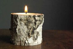If you're handy with a saw and a drill, turn wood from your backyard into rustic candle holders.