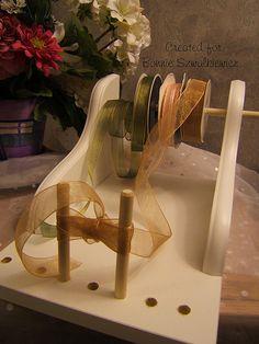 Bow Maker    http://craftiblog.wordpress.com/2011/03/05/2011-03-05-peg-bow-maker/
