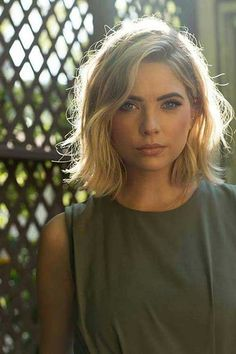 Beautiful Ashley Benson sporting a bob cut with elegant waves.