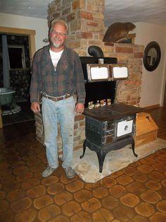 Steve Lee masonry heater, cordwood floor, river rocks on bathroom wall