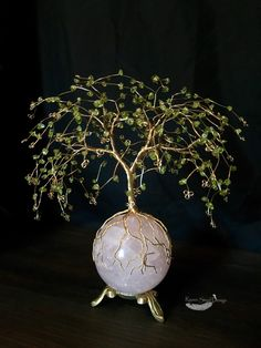 Tree of life. Peridot chip wire tree perched on rose quartz sphere. A personal favorite from my Etsy shop https://www.etsy.com/listing/460943406/peridot-chip-wire-tree-on-rose-quartz