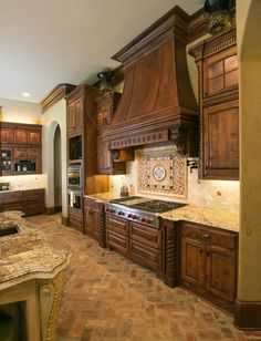 This kitchen is stunning! Look at those brick floors!