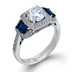 Passion Collection - This gorgeous 18K white gold ring is comprised of .23ctw round white Diamonds and .62ctw trapezoid cut Sapphires.  - MR2247-A