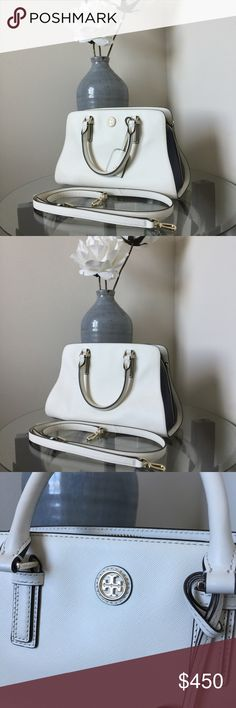 Tory Burch Robinson Color-Block Curved Satchel 🌷Please Read the description! Thanks!🌷  Mint condition. No marks, no stains. Used twice. 💯 Authentic. I am a TB bag lover. 😍 Measurements:  Retail: $550 New Ivory/Tory Navy. Style number: 11159770 Color may be slightly different bcz of lighting  Plz understand: ✅REASONABLE offers through offer buttons only ❌LOWBALL offers ❌TRADE Thank u for visiting my closet!  Happy shopping!💖 Tory Burch Bags Satchels
