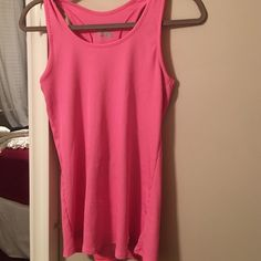 Under armour Hot pink!! Super bright!! Heat gear!! Bundle this beauty!! Under Armour Tops Tank Tops