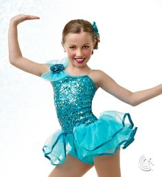 Curtain Call Costumes® - Glam Arabian blue nylon/spandex boy short leotard with sequin mesh bodice overlay and binding trim. Attached tricot bow and glitter flower trim and tricot peplum skirt. INCLUDES: glitter flower barrette. Troupe price: $65 AUD - $70 AUD