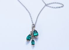 Floral white gold pendant with marquise cut tourmalines | Jon Dibben