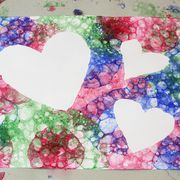 """It's fun to paint, and it's fun to blow bubbles. So it's no wonder that painting with soap bubbles is twice the fun. Bubble art has a great look and texture, with no two paintings ever looking alike. The design comes from the bubbles popping on paper, giving new meaning to the term """"pop art."""""""