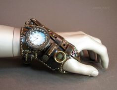 Steampunk watch/glove thing from Режу кожу - I cut leather--some really cool details and attachments here :) More pictures on the site, too! Something to keep in mind for potential future Steampunk gear accessories diy Часы ннннада? Gants Steampunk, Steampunk Gloves, Viktorianischer Steampunk, Design Steampunk, Costume Steampunk, Steampunk Accessoires, Steampunk Gadgets, Steampunk Clothing, Steampunk Fashion