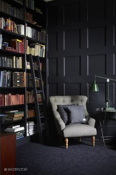 Dark and moody library with wingback chair, side table and lamp for hours of reading. Just need somewhere to put my feet up!