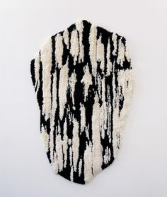 An exquisite hand-tufted wall hanging from Caroline Achaintre.