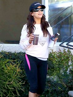 The naturally beautiful Eva Longoria stays shady in jet black, rectangular sunnies while out and about in Hollywood!