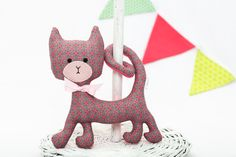 Curly Cat Rattle. The cat is a 100% handmade, 18×17 cm (appr. 7×7 in) stuffed rattling toy sewn of designer cotton. Its face is hand embroided, so it's absolutely safe for a baby.