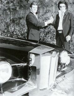 Accepting the keys for his Black Stutz Blackhawk at his Hillcrest home from dealership owner Jules Meyers in 1971