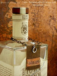 The  Bourbon Bottle Tag Collection  The Riveted Series  Layered Metal Bottle Labels with Vintage Equestrian Charms by Sycamore Hill, $42.00