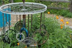 Wind chime from bicycle wheel and gears. I am converting this idea into a chandelier.