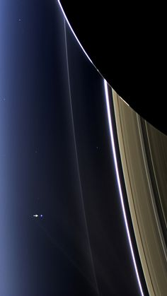 """"""" The Day the Earth Smiled """" In this rare image taken on July 19, 2013, the wide-angle camera on NASA's Cassini spacecraft has captured Saturn's rings and our planet Earth and its moon in the same..."""