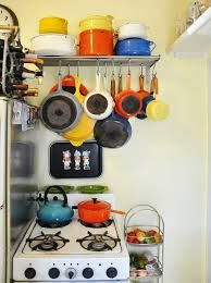 Pot holder grid to hang over the backside of the breakfast bar.. So when u walk in u can see the pots hanging above on the grid on the wall and below the opening to see the kitchen over the bar counter top