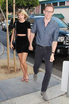 She's all mine! Tom Hiddleston is giddy with pride as he holds Taylor Swift's hand on dinner date