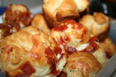 Pizza Appetizers-350 degrees 15-17 min. cut the canned biscuits into four pieces each, Chop the pepperoni into small pieces. Hold three to four biscuit pieces in your hands and have mama sprinkle mozzarella cheese & pepperoni on them. Pack & squeeze it all together like a snowball. Place into sprayed muffin tin.