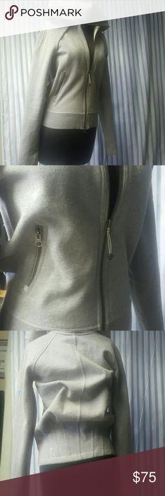 Lululemon grey Scuba jacket Grey Lululemon scuba jacket with two front pockets the Lululemon symbol on the back  pleats in the back of the jacket  think sweat material  extremely good condition lululemon athletica Jackets & Coats