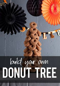 donut tree...who wouldn't love this at a halloween party? howdeosshe.com #donuttree