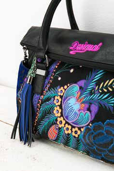 Bags. You can never have too many, right? This bag is the perfect complement to any outfit with its bright embroidered details and blue tasseled acccessory. It can also be worn as a messenger bag, making it as versatile and practical as it is beautiful! #XmasByDesigual