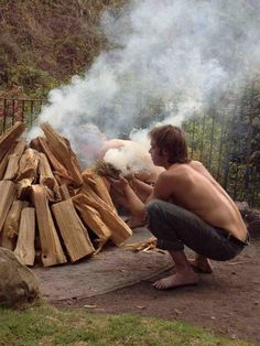 Mac tends the fire for a sweat lodge at Esalen