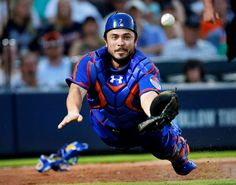 Almost -        New York Mets catcher Travis d'Arnaud dives but can't reach a ball bunted foul by Atlanta Braves pitcher Williams Perez on June 20 in Atlanta.  -   © John Bazemore/AP Photo