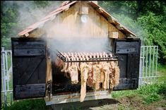 Smokehouse Construction - the pull out rack is genius!