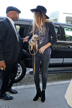 Amber Heard.. Led Zepplin 1977 T-shirt By And Finally, skinny jeans, black booties, and black blazer..