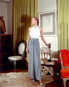 1944, model wearing slate blue and white Clare Potter dress.