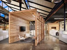 Gathering spaces are defined by crates made of repurposed wood from the warehouse. - Photo Credit: Casey Dunn