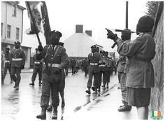 IRA Volunteers of the Derry Brigade of the Irish Republican Army parade through Derry City, British Occupied North of Ireland, 1970s