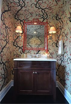 Love that the red mirror doesnt match the vanity!   Priscilla Fenlin interiors. clarence house paper- (pattern 'Flowering Quince')