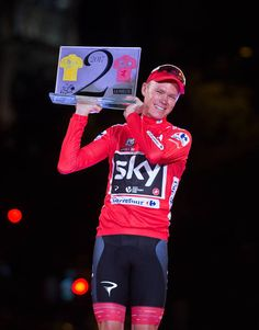 Britain s Chris Froome of Team Sky celebrates with his trophy for winning  the Tour de France 85eee6061
