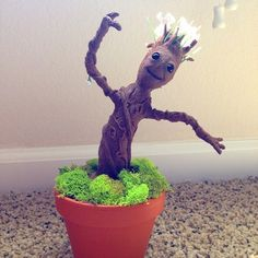 9 Ways To DIY Your Very Own Baby Groot @emily_austin we should add this to our porch!