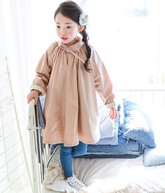 TheJany Ribboned Flare DressTreat your child something chic and fun with this dress that comes with round neckline, long sleeves, ribbon design, above the knee hemline and flare accent. Wear with leggings to finish the look.- Round neckline- Long sleeves- Ribbon accent- Peter pan collar- Above the knee hemline