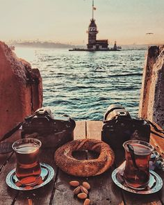 Turkish tea & simit in front of Maiden's Tower in İstanbul. Photographer: Abdullah Şahin (instagram.com/abdullahshhn) #turkey #türkiye #istanbul #tea #çay #turkishtea #türkçayı #simit #bagel #camera #canon #bosphorus #istanbulboğazı #galatatower #galatakulesi #goldenhorn #haliç #maidenstower #kızkulesi #leanderstower #towerofleandros