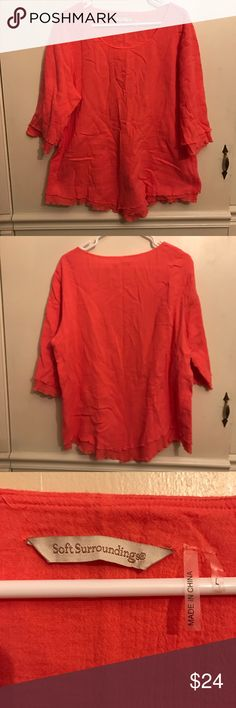 """Soft Surroundings Siesta Keys Coral Tunic Size L New without tags. Soft and easy, our double-layered, crinkled cotton gauze top with ruffly lettuce edges at the point hem and three-quarter sleeves is ready for your accessorizing. Lyocell. Misses 30"""" long. Color is Sunset Coral. 100% cotton. Comes from a smoke and pet free home. Soft Surroundings Tops Tunics"""