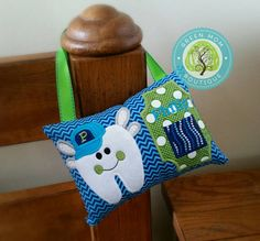 Whimsical tooth fairy pillow holder with baseball hat and wings by Green Mom Boutique. Keep the magic of the tooth fairy alive with this whimsical tooth fairy pillow keeper! Lime green, navy, turquoise blue chevron gift for preschool or elementary little boy with loose tooth.
